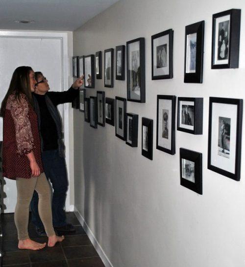 wall of photos in hallway